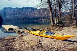 Yellow kayak on the mountain lake