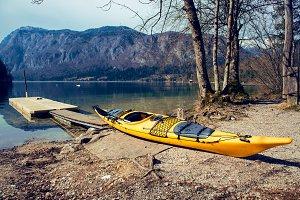 Yellow kayak on the mountain lake