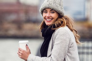 woman with a coffee cup in city