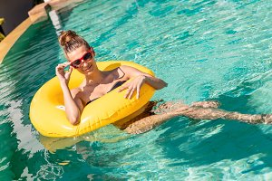 Beautiful girl have fun in the pool.