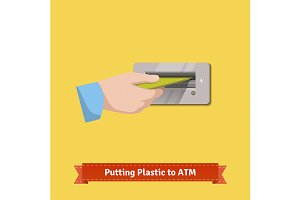 Hand putting credit card to ATM