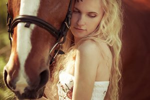 long-haired blonde with a horse