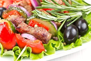 Beef meat grilled on wooden skewers