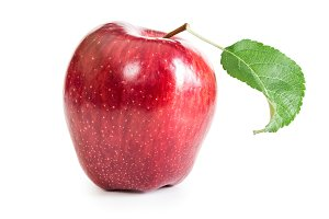 Red fresh apple with leaf