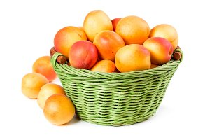 Ripe apricots in wicker basket