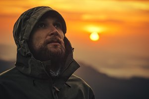 Man Traveler bearded face sunset