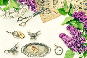 Lilac flowers, cake, antique dishes