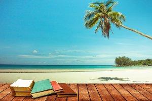 book and blue sea