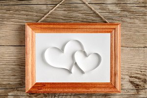 Two hearts in old picture frame