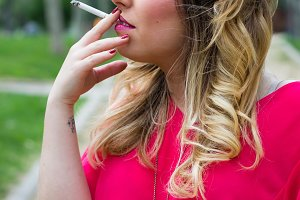 Beautiful girl smokes(VERTICAL)