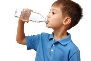 Child drinks water from bottle