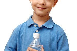 Happy child holds bottle of water