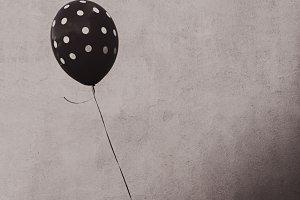 Boy's Hand Holding Balloon