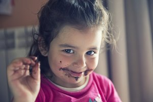 Girl with chocolate mouth