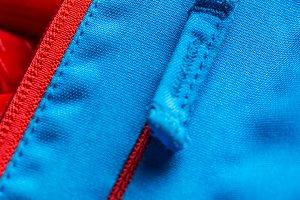 Zippered blue coat pocket