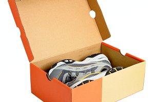 Pair of sneakers in cardboard box
