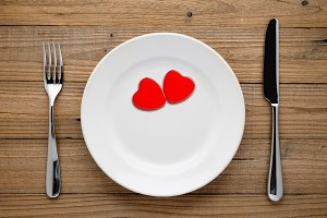 Two red hearts on plate