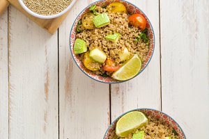 Quinoa salad on a white wooden