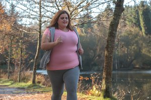 Woman running to lose weight