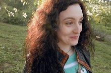 Pretty brunette long hair girl portrait outdoors