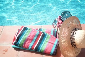 towel and bathing accessories near pool