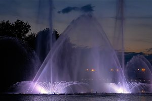 Bright fountain on the water pond or river