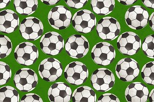 Soccer balls on green grass pattern
