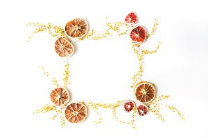 Floral frame with dry oranges