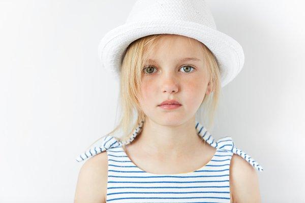 Cute Preschool Girl With Green Eyes And Blonde Hair Wearing