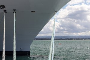 Bow of cruise ship docked in harbor