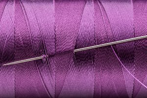 Purple thread and needle
