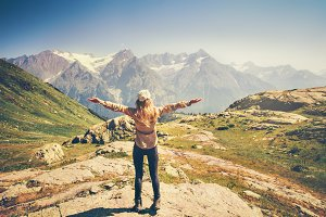 Woman Traveler hands raised hiking