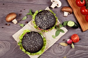 Two black burgers