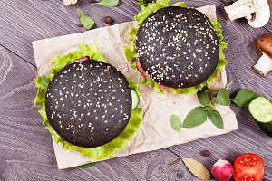 Two tasty black burgers with meat
