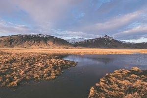 Golden Light over Field & Mountains