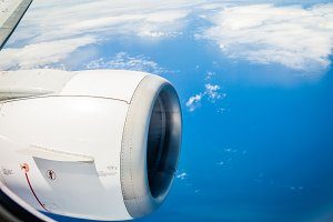 B737 engine in flight over water