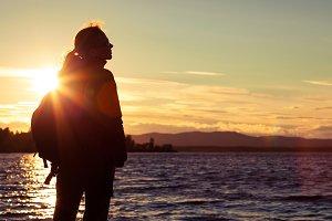 Happy woman standing near a lake