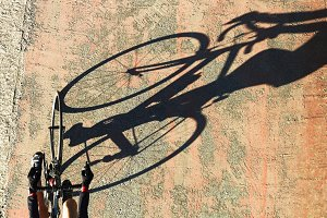 cyclist in bike and his shadow