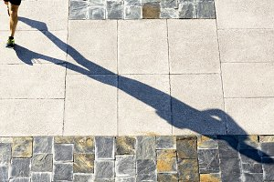 athlete with shadow in seafront