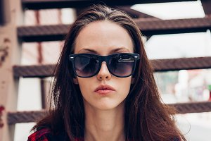 Beautiful girl in sunglasses look.