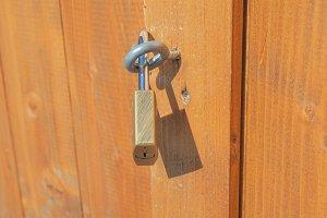 Padlock on a wood door
