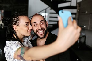 man and woman making selfie