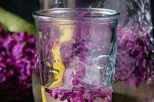 Lilac lemonade water with lemon