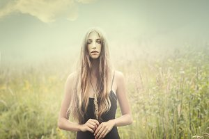 mysterious girl in a field