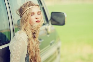 hippie girl near the car