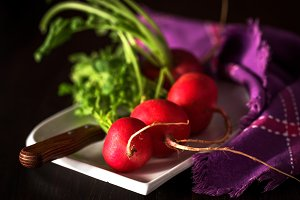 Two red radishes on white background