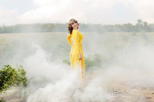 Outdoor portrait of a beautiful woman. Attractive girl in the smoke
