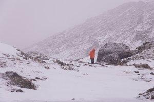 Man walking in snowy Landscape
