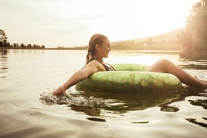 Young woman relaxing in water