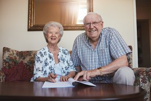 Smiling retired couple looking